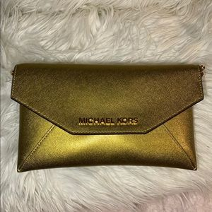 Micheal Kors sparkly gold purse with a wallet